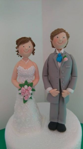 Sugar bride and groom made to customers requirements. (See fayes celebration cakes.) If you do need a model making please give me as much notice as possible.: Swipe To View More Images