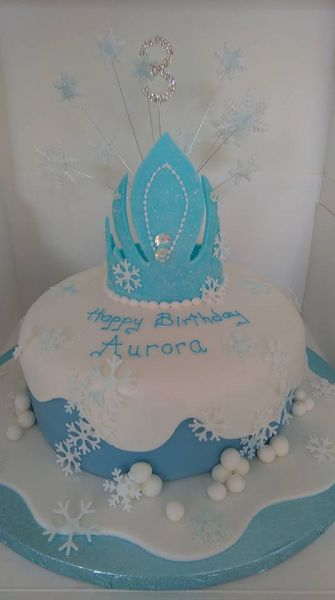 One for the lovers of frozen. Lots of magic sparkles and edible gems.a snowflake explosion with diamante number and hand made pastillage crown.: Swipe To View More Images