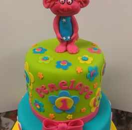 A very bright and cheerful first birthday cake. Happy birthday Penelope: Click Here To View Larger Image